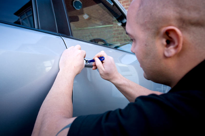 Car Locksmith Opening Car Door